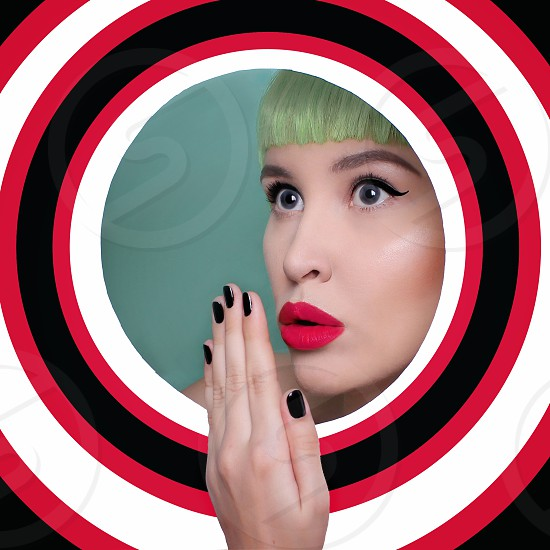 Art portrait of beautiful sexy unusual woman in round colored background photo