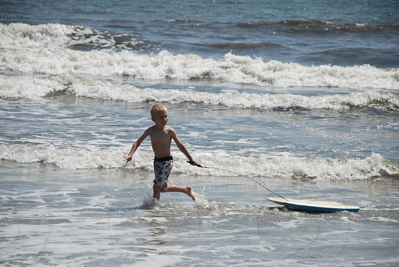 Pulling a boogie board in the surf photo