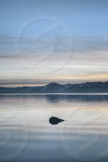 black textile on lake photo