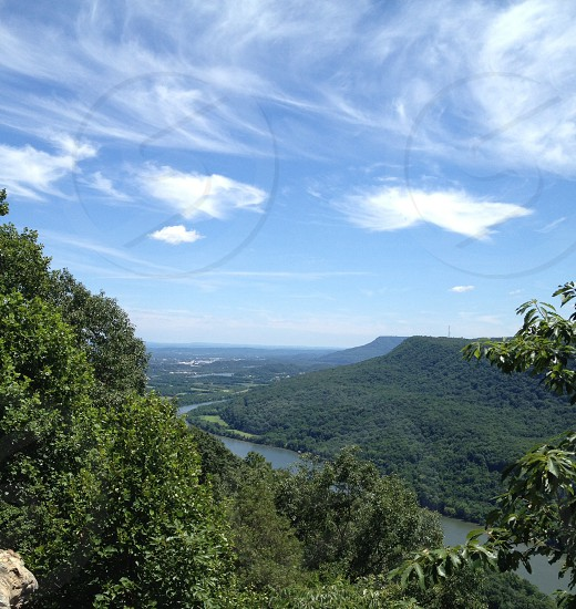 River mountains overlook wispy clouds trees outdoor photo