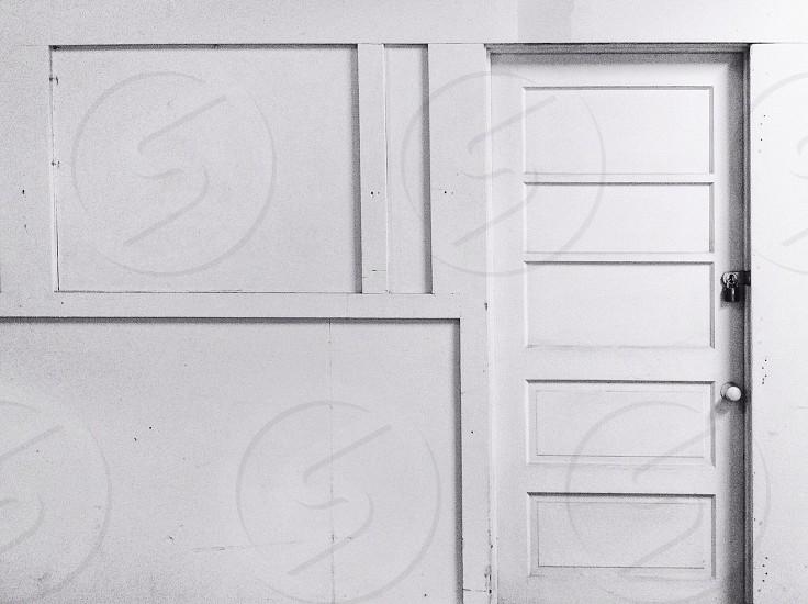 closed white wooden door photo