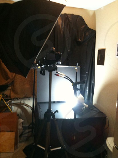 camera and lamp in room with white walls photo