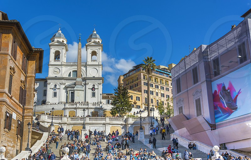 Crowd on Spanish steps in Rome in a sunny day photo