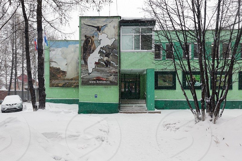 YELIZOVO CITY KAMCHATKA PENINSULA RUSSIA - JAN 5 2017: Kronotsky Reserve Visitor Center administration building of Kronotsky Nature Biosphere Reserve and Museum of Nature during snowfall. photo