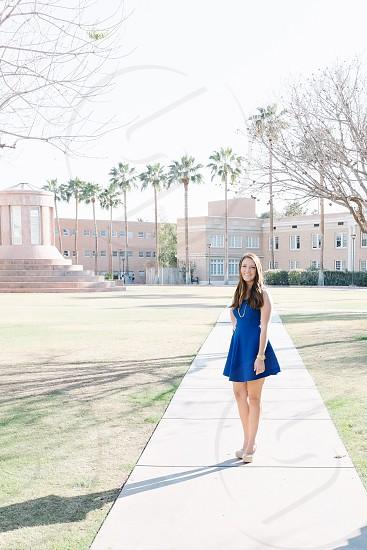 woman standing wearing blue dress photo
