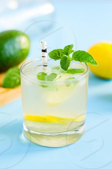 Homemade lemonade on blue background.  photo