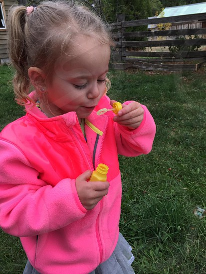 My Daughter blowing bubbles! photo