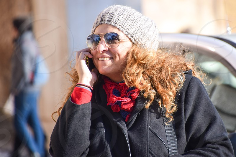 Happy Beautiful Business Woman Wearing Sunglasses And Talking On Cell Phone photo