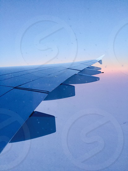 white airplane wing photo