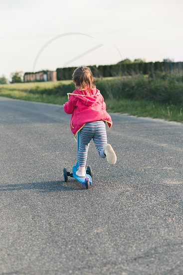 Young girl riding on roller skates. Real people authentic situations photo