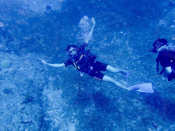 Scuba diver; underwater; ocean; British Virgin Islands; adventure; travel; woman photo