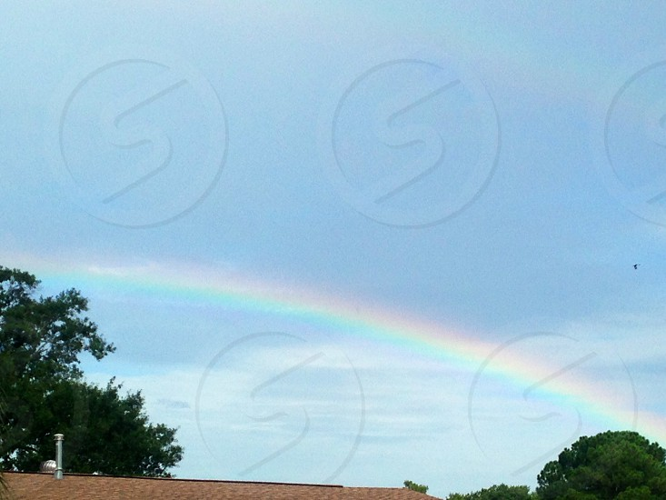 Beautiful rainbow with clear distinct colors photo