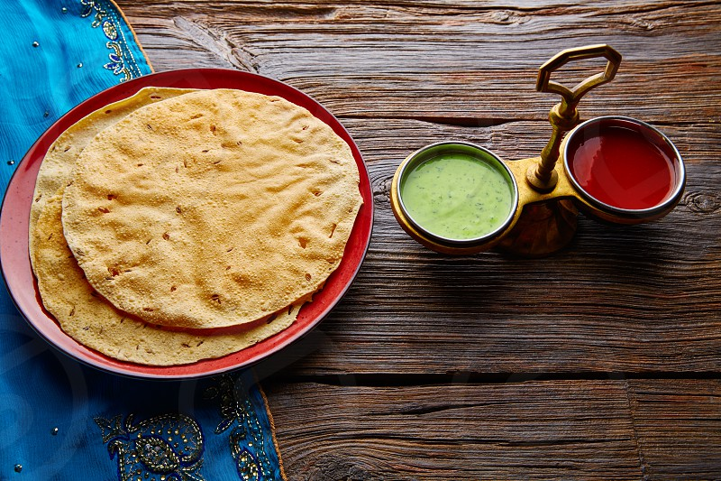 Appalam or Papadam brad with red and green sauces from Indian food papad photo