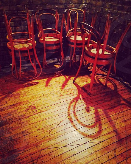 Stacked chairs rustic bar bar cafe chairs saloon hardwood floor chair. Shadows Cafe closing time bar photo