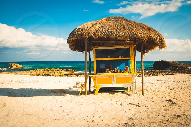 Bright yellow roadside stand on the beach in Cozumel Mexico. photo