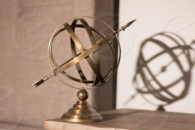 Old Brass globe and arrow photo