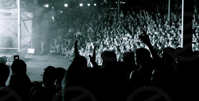 Fans enjoying an outdoor concert photo