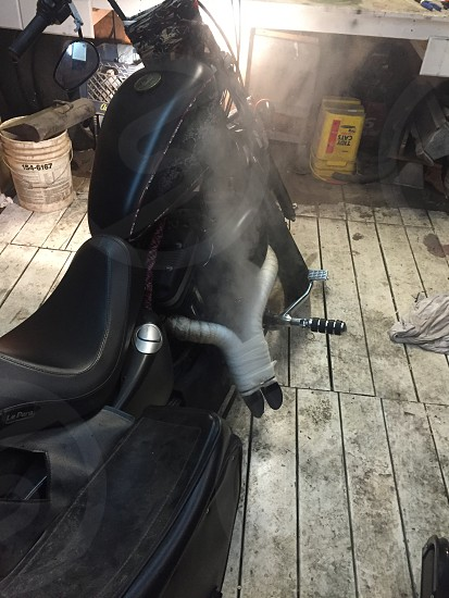 black chopper motorcycle inside garage photo