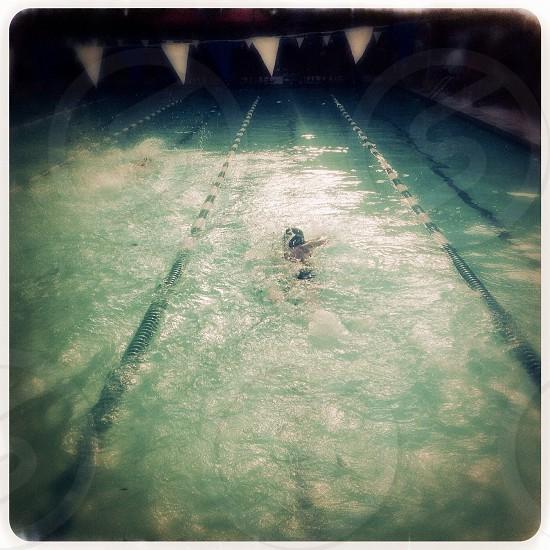Child swimming photo