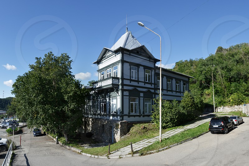 PETROPAVLOVSK-KAMCHATSKY KAMCHATKA RUSSIA - SEPTEMBER 7 2015: View of the old wooden building of the Kamchatka regional unified museum in Petropavlovsk-Kamchatsky City on Kamchatka Peninsula. photo