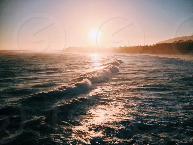 beach during sunrise photo