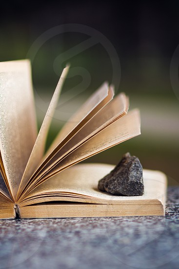 book with stone photo