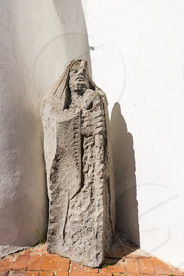 very old statutue in front of the church Stella Maris in Porto Cervo Costa Smeralda Sardinia Italy in the famous place of porto cervo where the rich and famous travel in summer photo