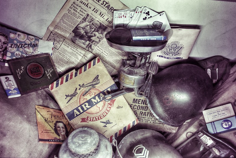 air mail letter camping stove military helmets fork and newspaper photo