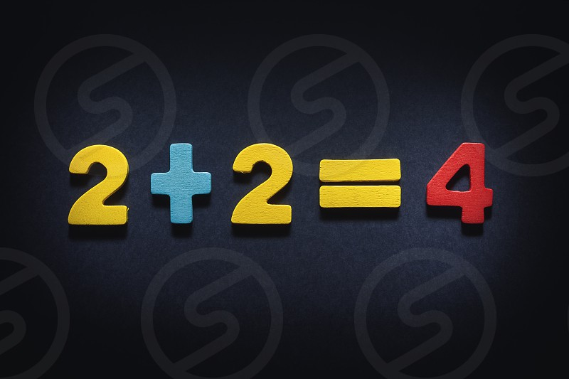 Two plus two equal four concept composition illustrates fairness. photo