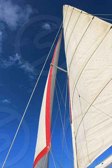 Sails sail boat colorful white Sky blue sailing ship catamaran vacation excursion journey travel island boating ropes wind sunny weather warm escape get away photo