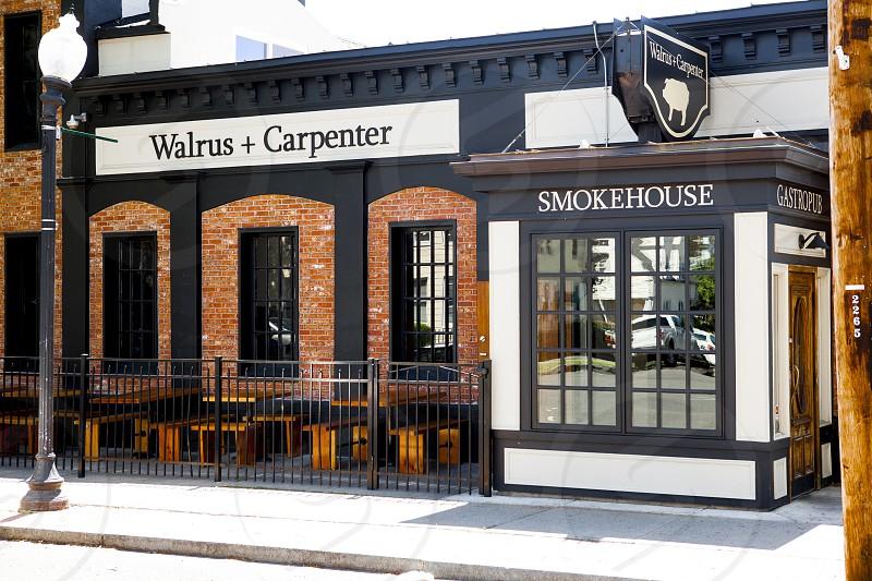 walrus + carpenter shop besides black post lamp during daytime photo