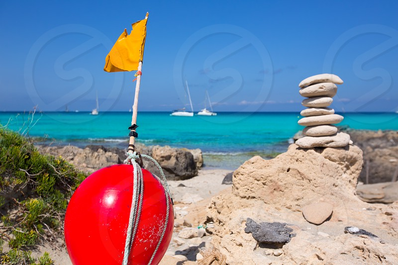 Stone figures on beach shore of Illetes beach in Formentera Mediterranean Balearic Islands photo