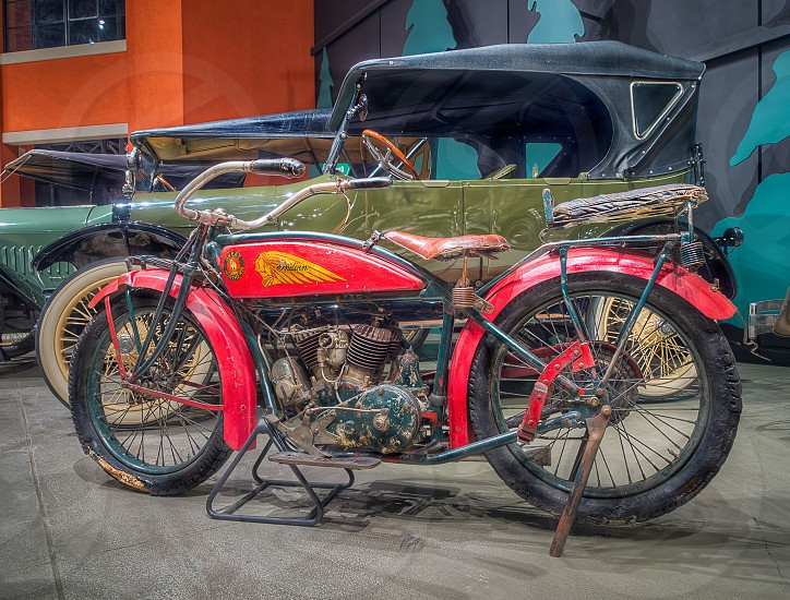 red and black indian vintage motorcycle photo