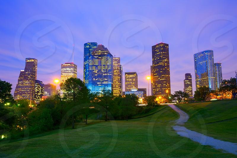 Houston Texas modern skyline at sunset twilight from park lawn photo