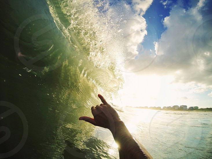 man in surf board riding the waves photo