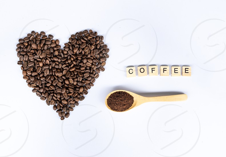 coffee beans in heart shaped with coffee word photo