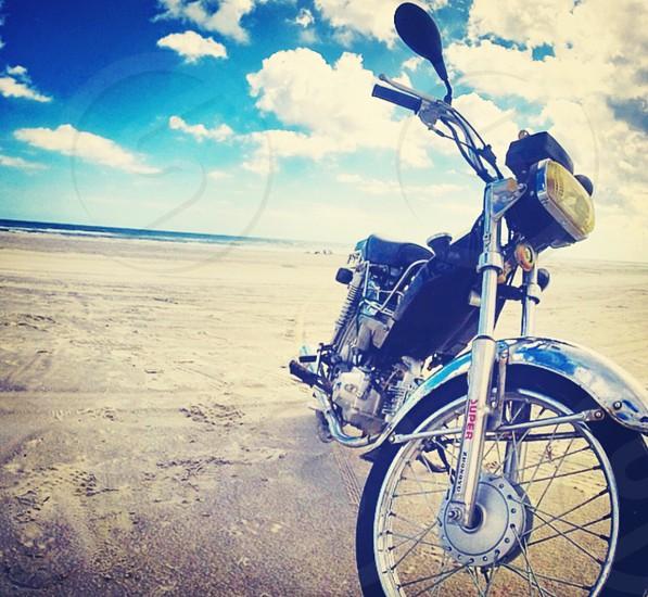 black motorcycle on beach photo