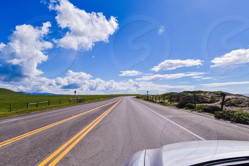 road road trip drive clouds sky california car sun highway 1 photo