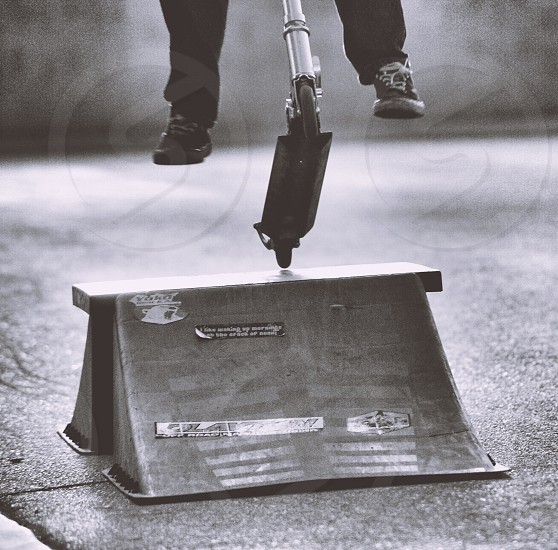 Jumping a scooter ramp photo