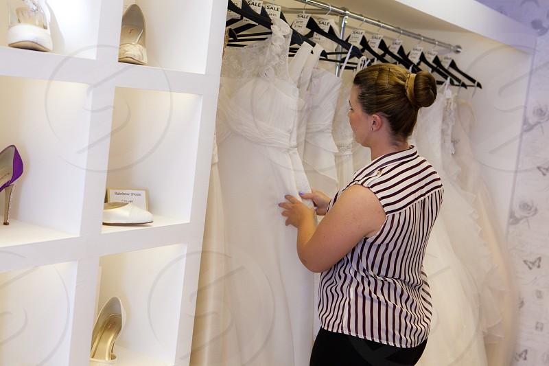 woman choosing a gown photo