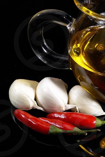 garlic olive oil and red chili pepper photo