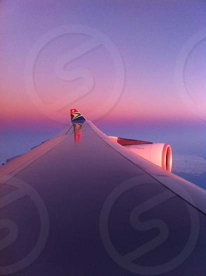 Sunrise over the wing of a South African Airways plane photo