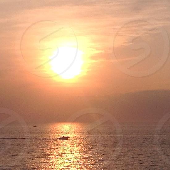 Boat crossing a Lake Michigan sunset photo
