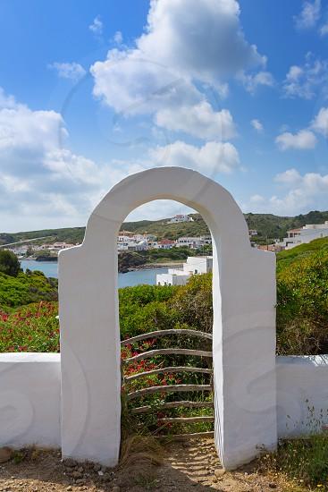 Menorca Cala Sa Mesquida Mao Maon arch entrance in Balearic islands photo