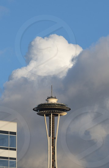 The Space Needle under cumulonimbus storm clouds in Seattle. photo
