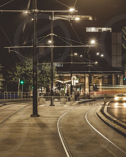 Melbourne Docklands Tram stop public transport Melbourne trams Collins landing Yarra trams Victoria long exposure movement blur night photography Ian Jones Photography tram lines station tram station Australia photo