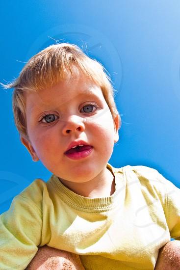 boy with blue eyes in yellow sweatshirt photo