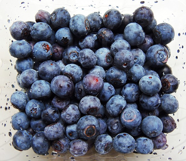 bulk of blueberry fruit on white container photo