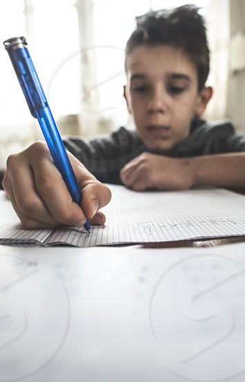 Child do his homework on mathematic photo