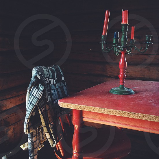 black and red candelabra on table photo